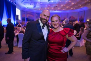 Well-dressed couple at Saints Ball 2018